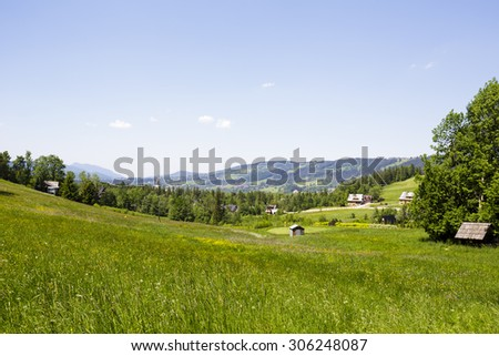 Meadows, forests and fields in the the town of Zakopane, it is an additional attraction of very well-known and frequently visited by tourists the city of southern Poland - stock photo