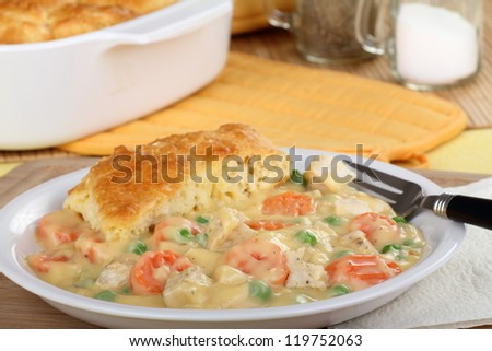 Meal of chicken pot pie with peas and carrots - stock photo