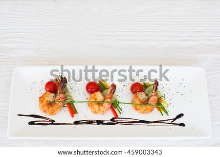 Meal of roasted prawns on white wooden background copyspace, flat lay. Menu of seafood restaurant concept - stock photo