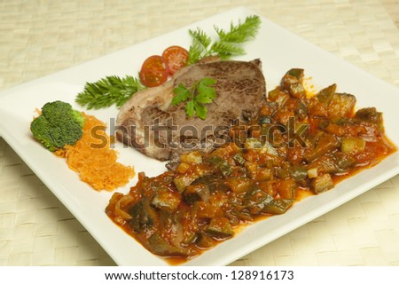 meal with meat and ratatouille - stock photo