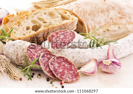 meal with salami and bread - stock photo