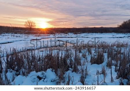 meandering creek in long meadow lake unit of minnesota valley wildlife refuge in bloomington minnesota at sundown  - stock photo