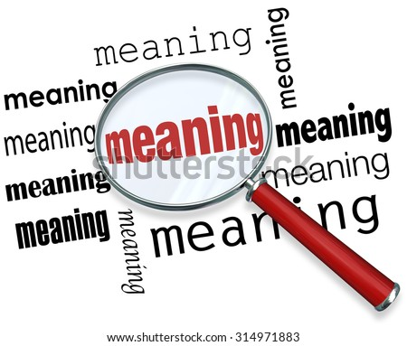 Meaning word under a magnifying glass to illustrate looking for, searching and finding a definition, context, purpose, mission or belief - stock photo
