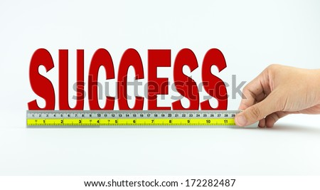 Measure of success concept using ruler - stock photo