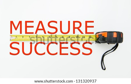 Measure of success conceptual using measuring tape - stock photo