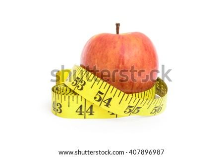 Measure tape and apple. Dieting concept - stock photo