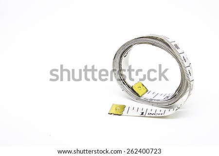 Measure tape on white background - stock photo