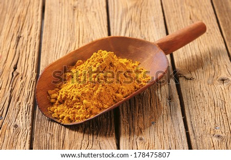 measured portion of curry powder - stock photo