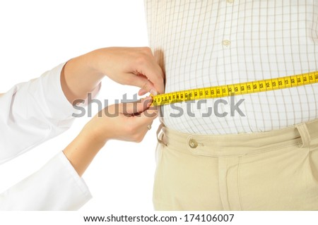 Measurement of a fat man - stock photo