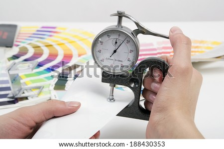 Measurement of thickness of a material by a micrometer - stock photo
