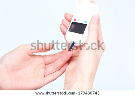 Measuring glucose level blood close-up - stock photo