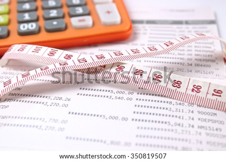 Measuring tape ,calculator, on account book. selective focus. business concept - stock photo