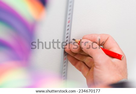 Measuring tape in use by handyman. - stock photo