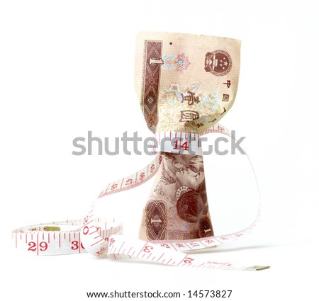 measuring tape tide over China money - stock photo