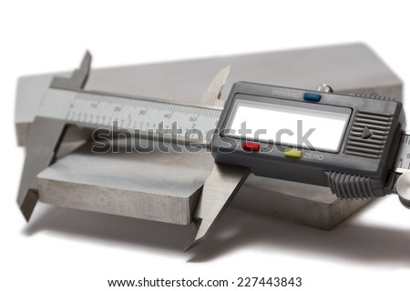 Measuring the dimensions of detail by caliper  - stock photo