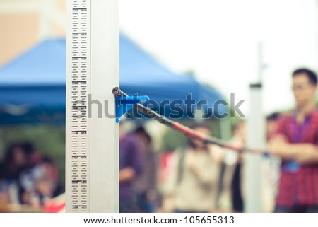 measuring the high jump athletics - stock photo