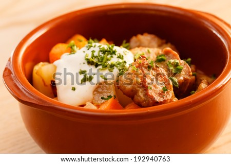 meat and vegetables in the pot - stock photo