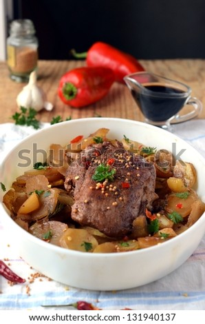 Meat baked with potatoes and spices - stock photo
