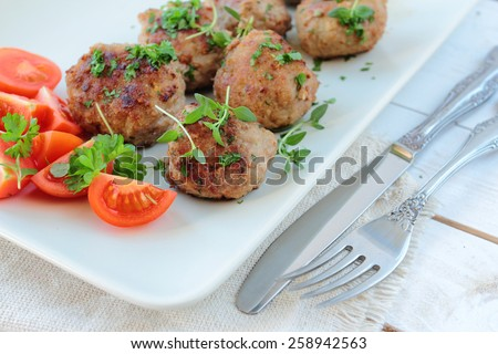 Meat balls with parsley and thyme herbs - stock photo