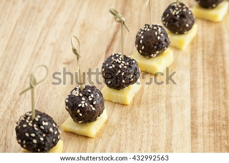 Meat balls with sesame and pineapple for party finger food. - stock photo