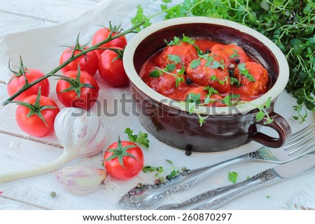 Meat balls with tomato sauce in a bowl - stock photo
