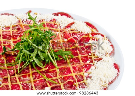 Meat (beef) Carpaccio with Parmesan Cheese and ruccola - stock photo
