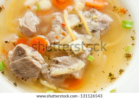 meat broth with homemade noodles, closeup soup - stock photo