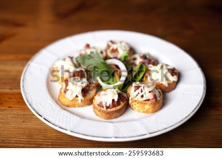Meat Canapes on White Dish. - stock photo