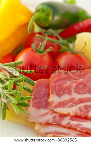 Meat, cheese, tomatoes and salad for sandwich preparation - stock photo