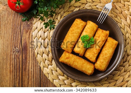 Meat croquettes served with fresh vegetables. - stock photo
