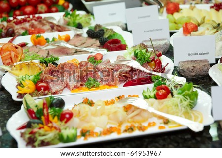 Meat, fish and fruits in expensive hotel restaurant - stock photo