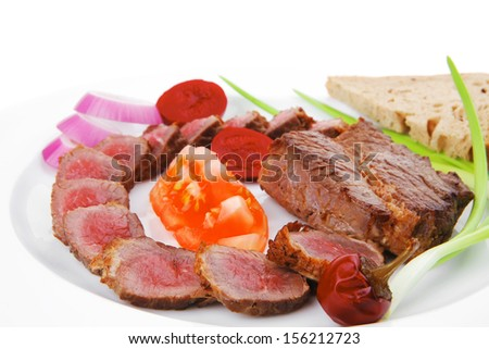meat food : bbq meat served on white plate with tomatoes , sprouts and bread isolated on white background - stock photo