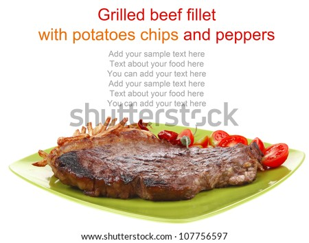 meat food : big grill beef meat steak on green square plate with dry hot chili pepper and cherry tomato isolated on white background - stock photo