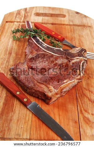 meat food : grilled beef spare rib on wooden plate with thyme - stock photo