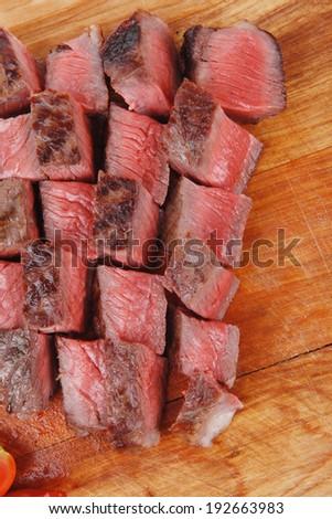meat food : roast beef steak on wood plate isolate on white background - stock photo