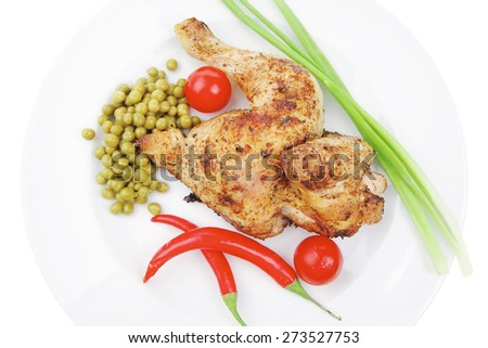 meat food : roast chicken garnished with green onion and red chili hot pepper on white plate isolated over white background - stock photo