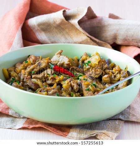 Meat hot ragout with pork, beef, vegetables, onion, carrot and zucchini in plate - stock photo