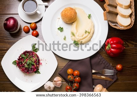 Meat in Breadcrumbs, Salad And Cup of Coffee On A Table - stock photo