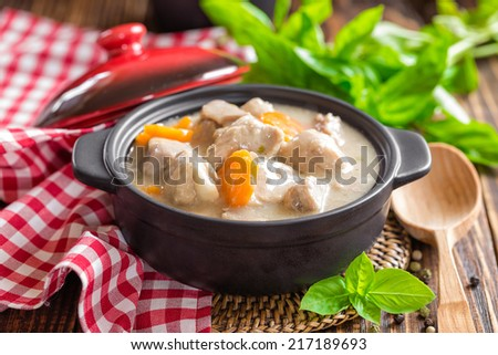 Meat in sauce with vegetables - stock photo