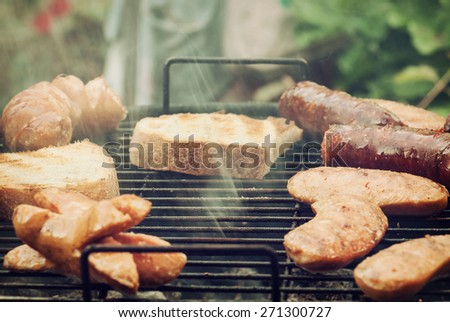 Meat is baked on the hot grill. Summer picnic. Leisure activities. - stock photo