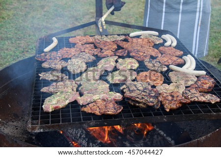 Meat is grilled - stock photo