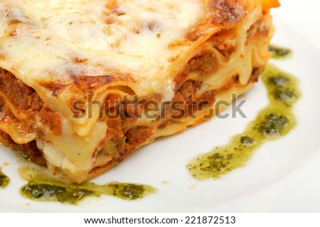 Meat lasagna with herb. Shallow DOF with focus on lasagna.  - stock photo
