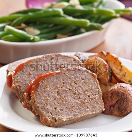 Meat loaf with roasted herb potatoes meal - stock photo