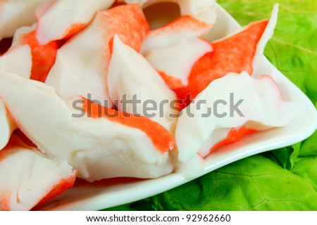 Meat of a crab and greens. - stock photo
