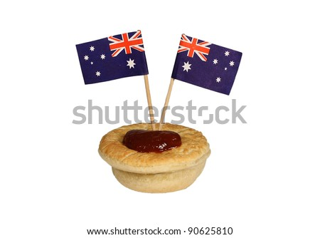 Meat pie with tomato sauce and 2 small Australian flags isolated on white - stock photo