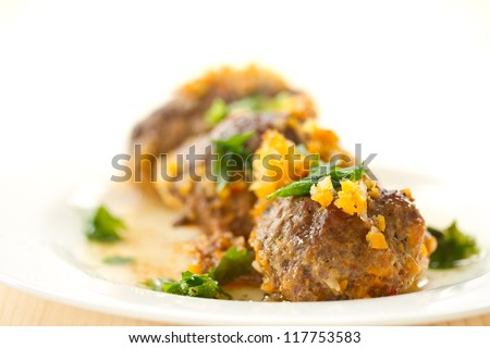 meat quenelles with vegetables also add on a plate - stock photo