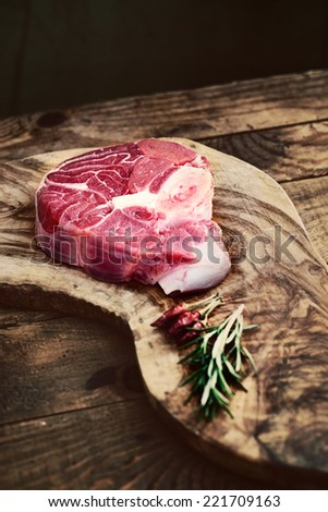 Meat. Raw meat. Beef steak on  black with herbs - stock photo
