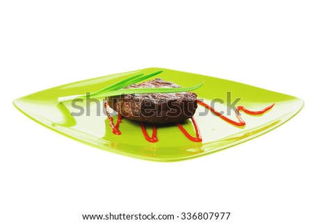 meat savory : grilled beef fillet mignon on green plate with chives and ketchup isolated over white background - stock photo