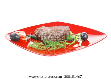 meat savory : grilled beef fillet mignon on red plate with tomatoes apples and pepper isolated over white background - stock photo