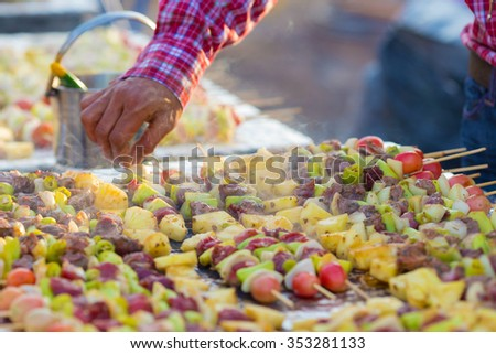 Meat slices barbecued with vegetables prepares on grill - stock photo